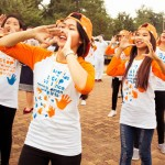 "Fifty boys and girls of various ages wearing the orange Strong Hands t-shirts and caps put on a flash mob dancing in sync.  It was one of the events that took place at the National University of Lao, Dong Dok campus on December 4th. It was a joint collaboration amongst UN Women, UNFPA, NCAW, NUOL, Fanglao and Hoppin.  ""It is important for boys to respect girls because girls support us in everything we do, our Mothers have taken care of us, we have to do our part to take care of them."" - Kaka, Director/Choreographer of Fanglao/Hoppin   Photo: DANHO/Daniel Hodgson"